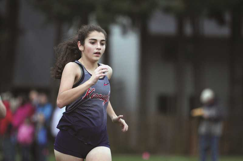 PMG PHOTO: PHIL HAWKINS - Kennedy junior Cassie Traeger finished with her first top-10 placement in a high school 5K on Stayton on Thursday, finishing 8th overall with at time of 22:17.60 to lead the Trojans.