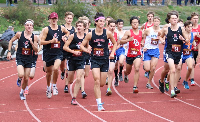 PMG PHOTO: JIM BESEDA - Clackamas runners fill the outside lanes at the start of Wednesday's Mt. Hood Conference/Portland Interscholastic League cross country meet at Grant High School in Northeast Portland.