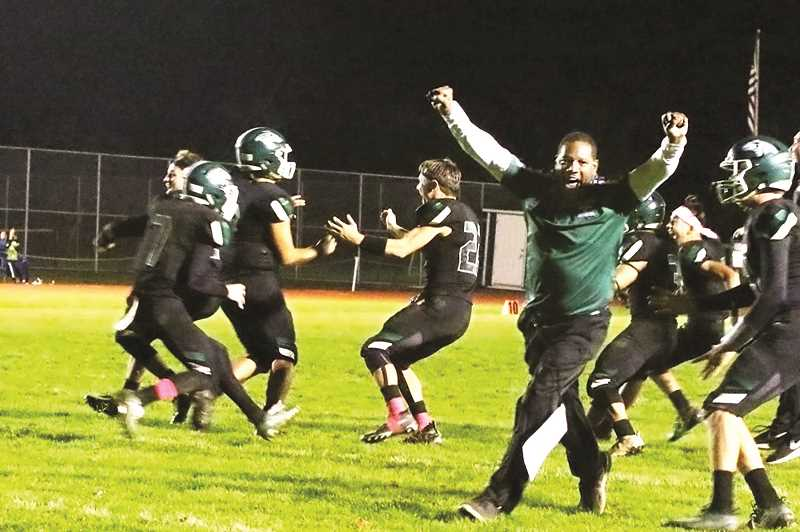 COURTESY PHOTO: JO WHEAT - The North Marion football team celebrates after Sergio Jimenez hit the game-winning field goal to lift the No. 8 Huskies to a 17-14 victory over the Crook County Cowboys.