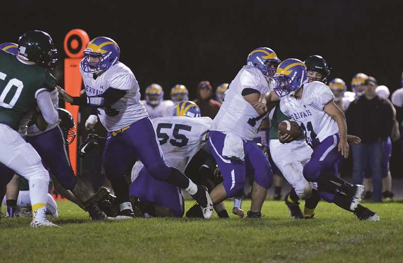 PMG PHOTO: DEREK WILEY - Gervais senior Xadan Ramon looks for a seam up the middle against the Colton Vikings on Friday.