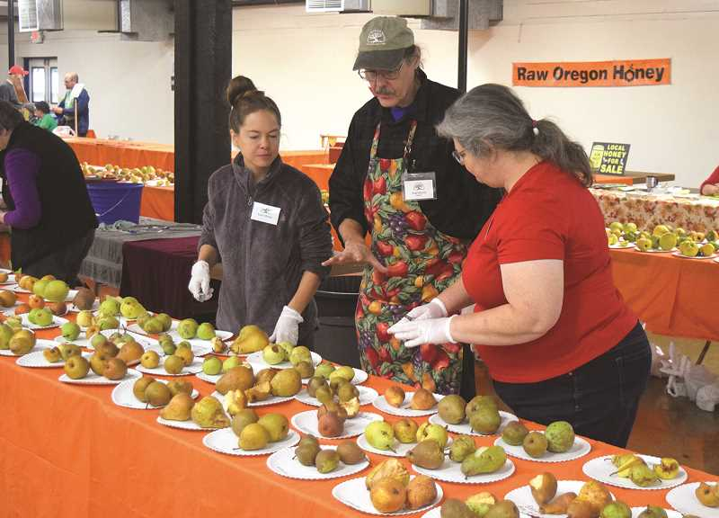 PMG FILE PHOTO: JOHN BAKER - Guests are invited to sample hundreds of varieties of fresh fruit at the Oct. 19 Fruit Show in Canby. Each crop of produce has dozens of different strains, each with their own unique flavor, sweetness and texture components.