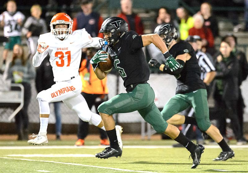 COURTESY PHOTO: CHRIS GERMANO - Tigard High School senior Max Lenzy breaks into the clear on his way to scoring one of his three big-play touchdowns in the Tigers' 56-0 win over Sprague on Friday.