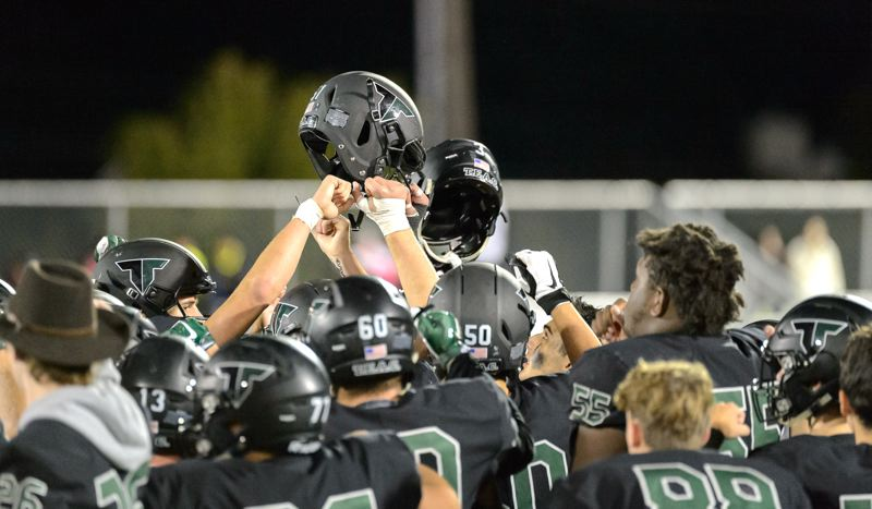 COURTESY PHOTO: CHRIS GERMANO - Members of the Tigard High School football team gather following the Tigers' 56-0 win over Sprague in Friday's non-league contest.