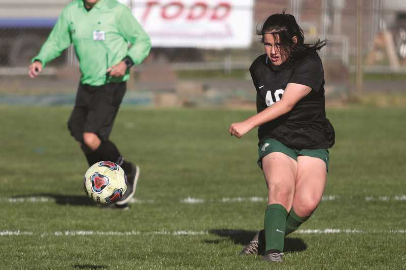 PMG PHOTO: PHIL HAWKINS - North Marion sophomore Jo Carbajal and the No. 6 Huskies are tied with No. 9 Molalla for second place in the Tri-Valley Conference after losing 3-0 to No. 2 Gladstone on Thursday.