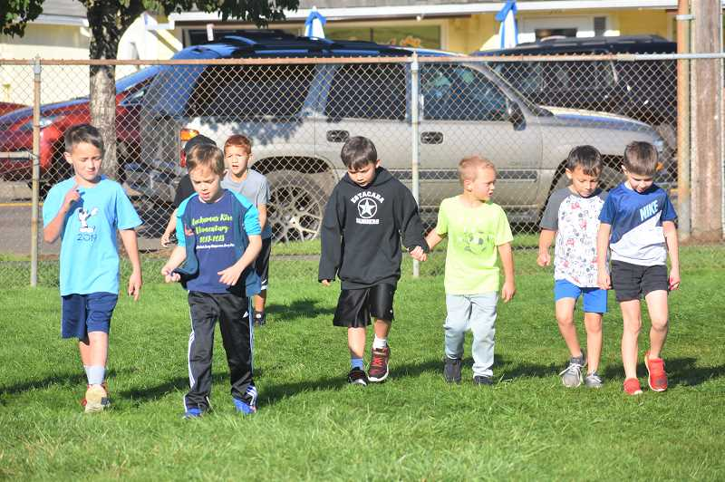 PMG PHOTO: EMILY LINDSTRAND - Clackamas River Elementary School students walk united during the schools jog-a-thon on Wednesday, Oct. 2.