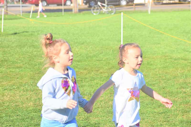 PMG PHOTO: EMILY LINDSTRAND - Clackamas River Elementary School students run together during the school's jog-a-thon last week.