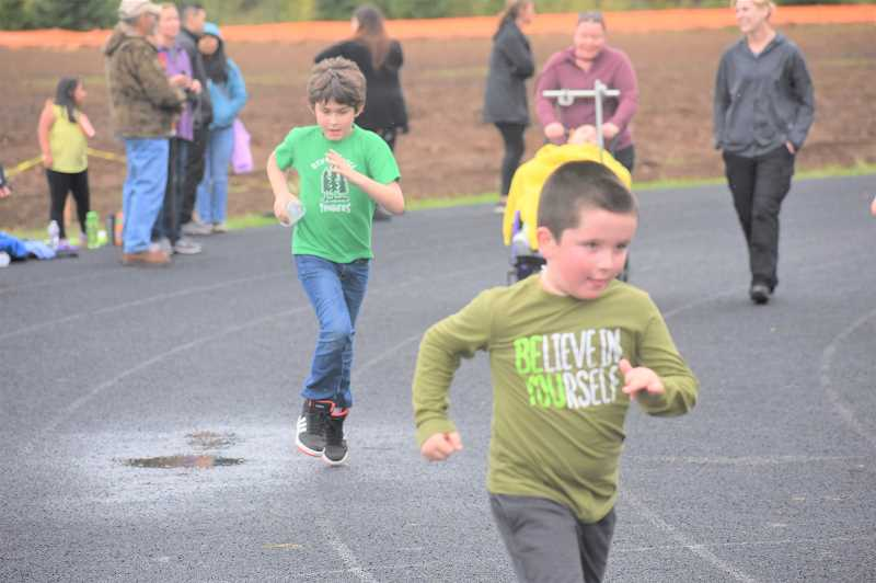 PMG PHOTO: EMILY LINDSTRAND - River Mill Elementary School students are determined to complete their laps during the school's jog-a-thon on Friday, OCt. 4.