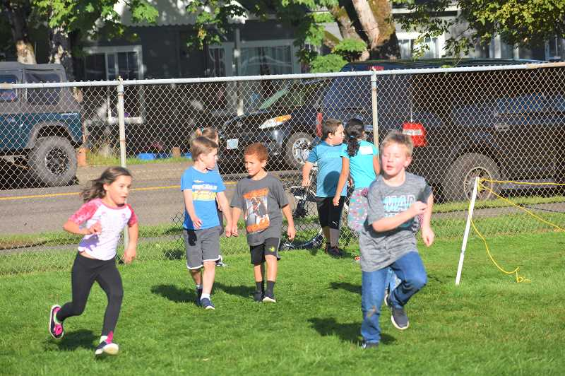 PMG PHOTO: EMILY LINDSTRAND -  Clackamas River Elementary School journeyed around the track during their jog a thon last Wednesday.