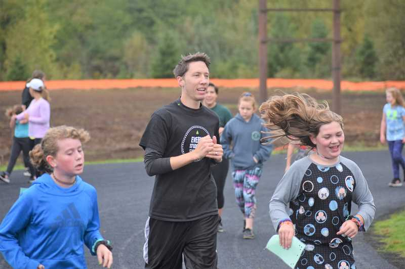 PMG PHOTO: EMILY LINDSTRAND - River Mill Elementary School students and community members ran around the track during their jog-a-thon last week.