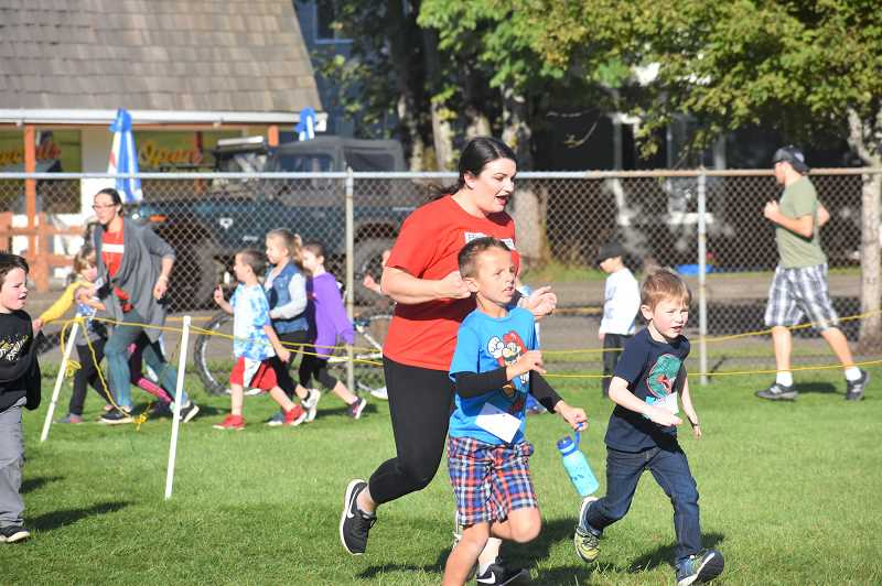PMG PHOTO: EMILY LINDSTRAND - Elementary school teachers joined their students in running around the track during jog a thons last week.