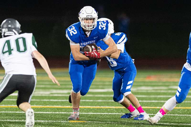 PMG PHOTO: CHRISTOPHER OERTELL - Hillsboro's Slade Shufelt (32) carries the ball during the Spartans' blowout nonleague win over Wilson Friday, Oct. 4, at Hare Field. The Spartans will travel to Forest Grove this week for a key league game with the Vikings.