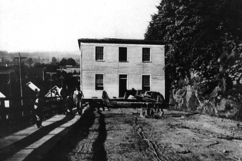 COURTESY PHOTO - In this historic photo, the McLoughlin House is moved up Singer Hill in 1909 from its original location next to Willamette Falls in Oregon City.