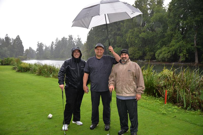 COURTESY PHOTO - David Salazar, Ryan Murphree and Eric Lekberg help raise money for the Clackamas Sunrise Rotary Foundation during its 12th-annual Humanity in Motion Golf Tournament.