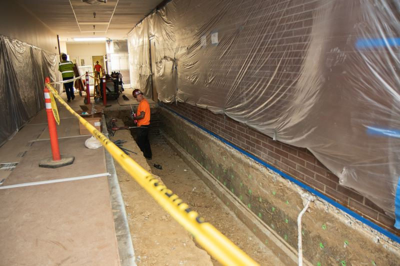 PHOTO COURTESY BEAVERTON SCHOOL DISTRICT - A contractor does foundation work at Aloha High School as part of a seismic upgrade project. The project will see the school retrofitted to be earthquake ready.