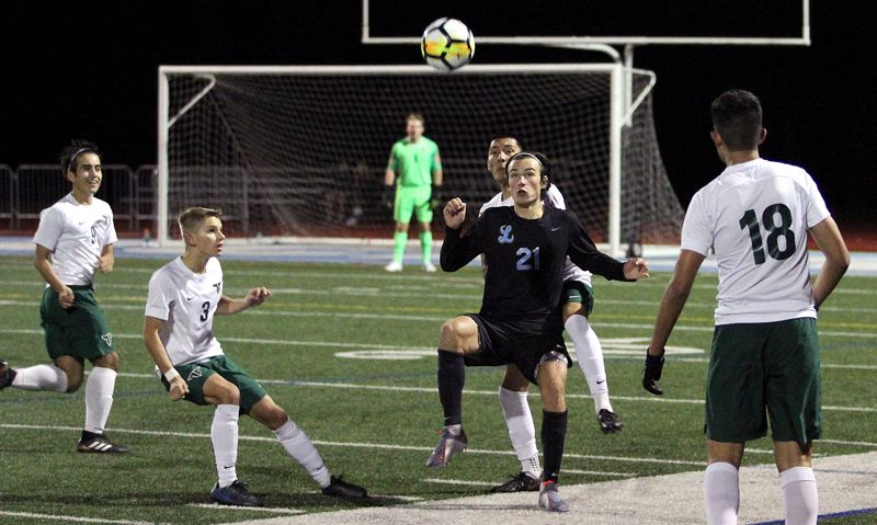 PMG PHOTO: MILES VANCE - Lakeridge's George Kohnstamm gets ready to make a play during his team's 4-0 loss to Tigard at Lakeridge High School on Thursday, Oct. 4.