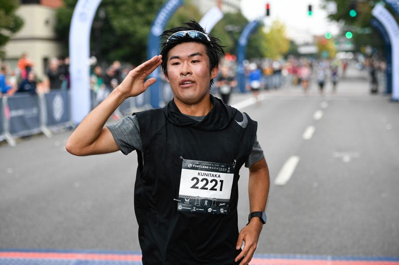 PMG PHOTO: CHRISTOPHER OERTELL - Kunitaka Imaizumi crosses the finish line in second place in Sunday's Portland Marathon.