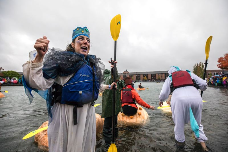 PMG FILE PHOTO - Annie Meneakis cheers after finishing a race at the West Coast Giant Pumpkin Regatta in Tualatin.