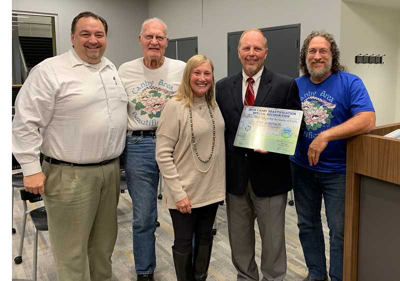 CAROL ROSEN - Canby Beautification presented City Administrator Rick Robinson with a Special Recognition award at the Oct. 2 City Council meeting. (From left) Mayor Brian Hodson, CAB's Vern Hulit, CAB President Cathy Rae Smith, Robinson and CAB's Haunt Rama.