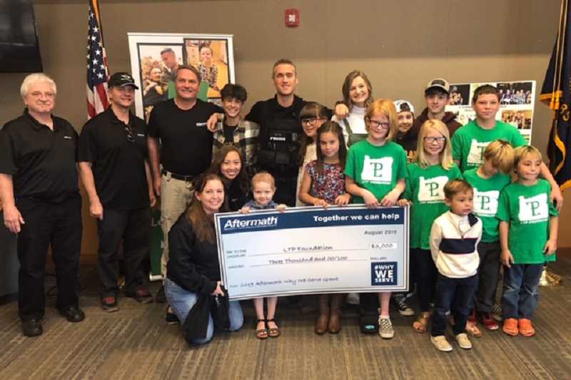 COURTESTY PHOTO: WEST LINN POLICE DEPARTMENT  - West Linn Police Officer was awarded $3,000 for taking second place in Aftermath's Why We Serve Grant Contest.