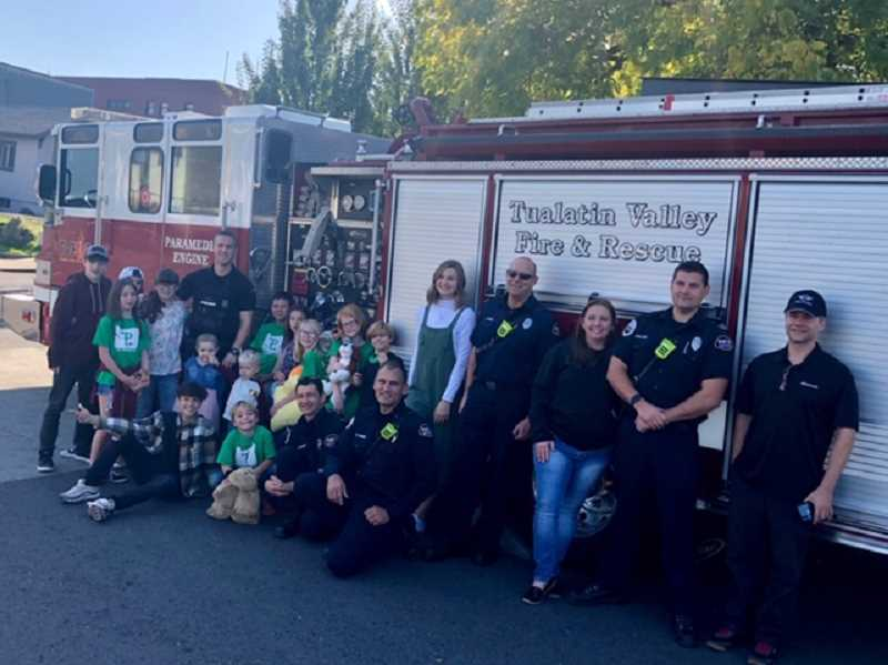 COURTESY PHOTO: WEST LINN POLICE - Campers from Camp Millenium, which is where the $3,000 will go, joined Blyth to accept the check. Blyth and the campers also got a visit from Tualatin Valley Fire and Rescue.