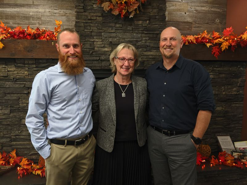 PMG PHOTO: BRITTANY ALLEN - Jarrett Stuchlik, Cathy Stuchlik and Justin Stuchlik own and operate Clackamas County Bank, with branches in Sandy, Boring, Welches and Gresham.