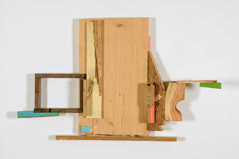 COURTESY PHOTOS  - Border Town, by James Florschutz, will be on exhibition at LAURA VINCENT DESIGN AND GALLERY through Nov. 2. It is made of salvaged wood and mixed media.