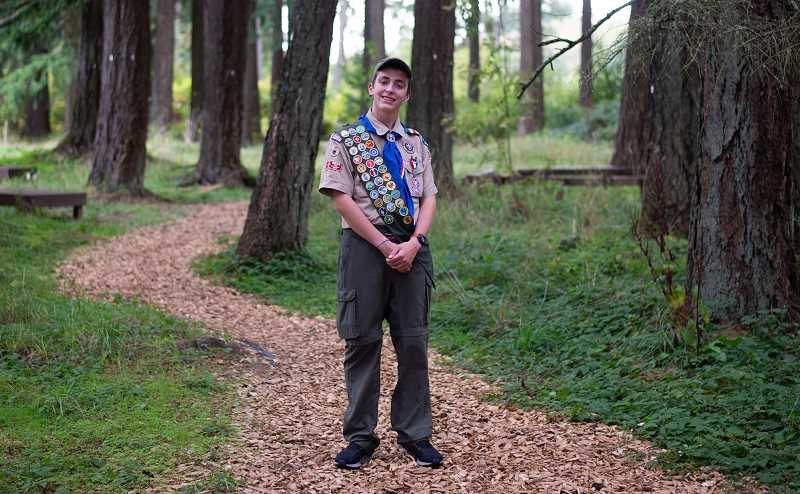 PMG PHOTO: ANNA DEL SAVIO - Alex Tye stands on the path he worked on for his Eagle Scout project. Tye chose a project at Trillium Creek, where he attended primary school, because he said he wanted to give back to a place that had given him so much.