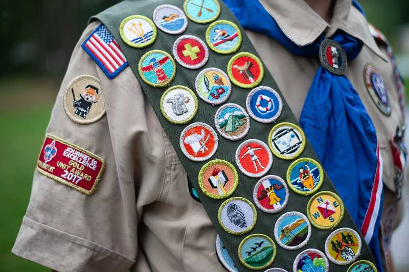 PMG PHOTO: ANNA DEL SAVIO - Alex Tyes Scout uniform showcases more than 30 merit badges that hes earned over the years.