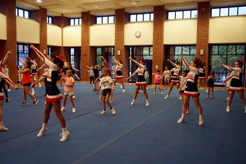 PMG PHOTO: CLAIRE HOLLEY - The Laker cheer team was there to provide one-on-one instruction with campers when needed.