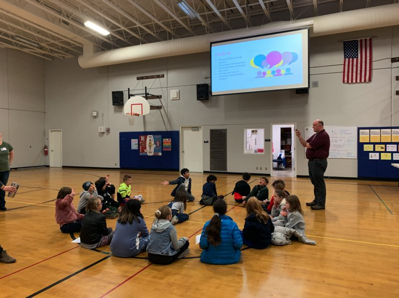 PMG PHOTO: CLAIRE HOLLEY - Westridge Elementary School counselor Gary Kieser leads the students in a reflection after the activities.