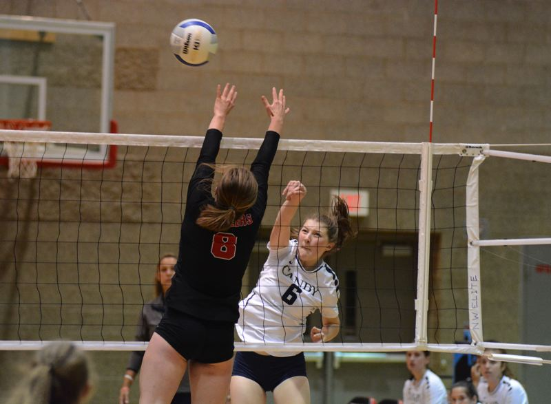 PMG PHOTO: DEREK WILEY - Canby junior Daphne Kropf hits the ball over the net Tuesday night at Oregon City.
