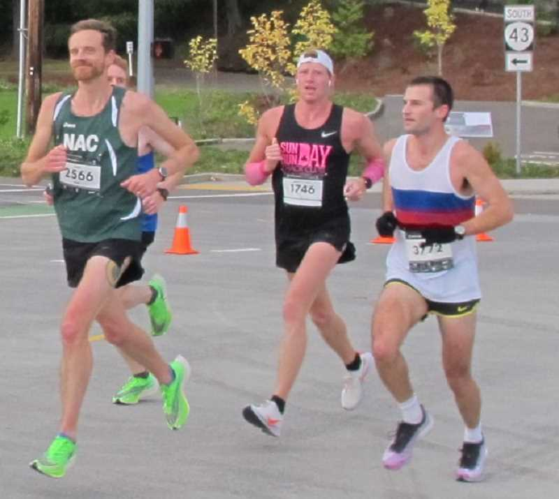 Four of the runners who were running behind Khan until going off course and heading down Barbur Boulevard. Matt Spear (3772) went on to finish in fifth place and first in his age group 30-34. Matt Collins (1746) finished eleventh and first in his age group 25-29.