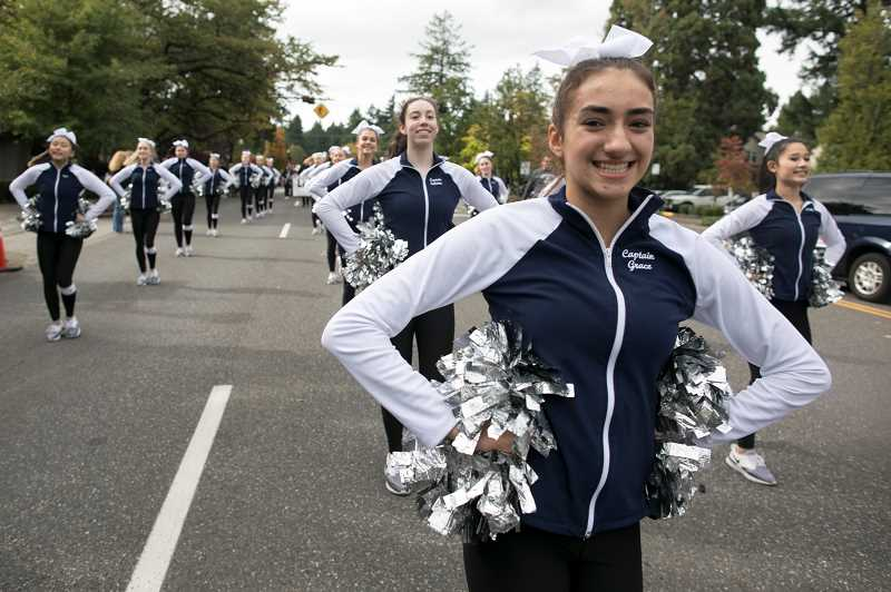 PMG PHOTO: JAIME VALDEZ - Laker dance captain Grace Freemont leads the team down A Avenue.