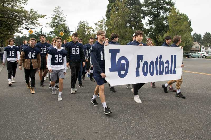 PMG PHOTO: JAIME VALDEZ - The Laker football team got cheers and support from the crowd as they made their way down the street.