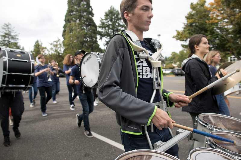 PMG PHOTO: JAIME VALDEZ - The marching band heads down A Ave. during the parade.