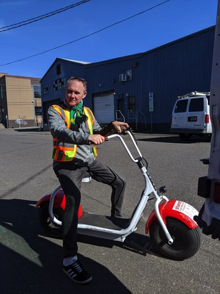 PAMPLIN MEDIA GROUP: JOSEPH GALLIVAN  - Easy rider: the author on a Shared, the new e-scooter company in town. Slow and heavy, yes, but dependable. And that's just the bikes.