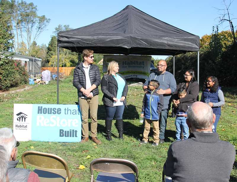 PMG PHOTO: JUSTIN MUCH - The Ortega family, right, said the House that ReStore Built, was like a dream come true. They were among dozens of people who attended a ground breaking ceremony in east Woodburn, hosted by North Willamette Valley Habitat for Humanity, Thursday, Oct. 10.