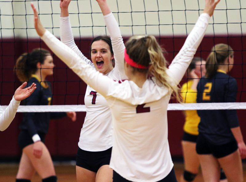 PMG PHOTO: DAN BROOD - Sherwood High School seniors Josie Wilson (7) and Allison Fiarito celebrate after the Lady Bowmen score a point in their conference sweep against Forest Grove on Oct. 9.