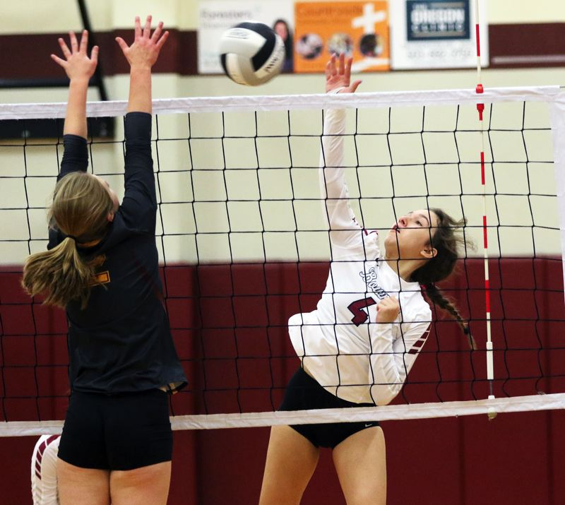 PMG PHOTO: DAN BROOD - Sherwood High School sophomore Gianna Friendly (right) goes up for a kill during the Lady Bowmen's 3-0 victory over Forest Grove.