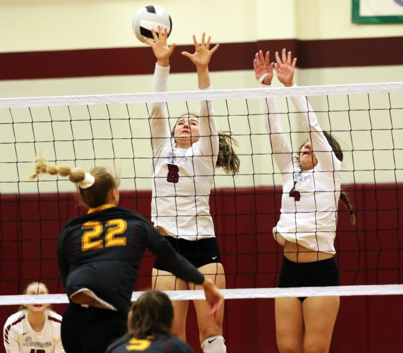 PMG PHOTO: DAN BROOD - Sherwood High School sophomores Emma Wagner (8) and Gianna Friendly go up for a block during the Lady Bowmen's victory over Forest Grove.