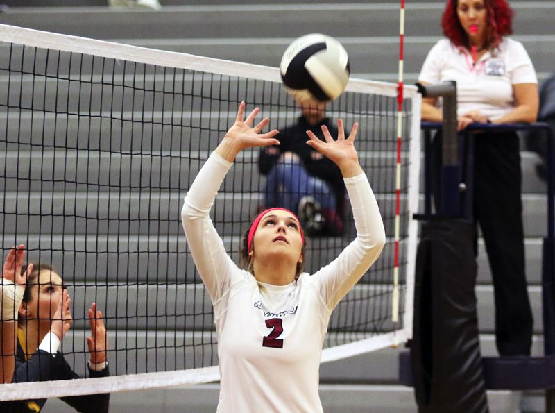 PMG PHOTO: DAN BROOD - Sherwood High School senior Allison Fiarito sets the ball during the third set of the Lady Bowmen's victory against Forest Grove on Oct. 9.