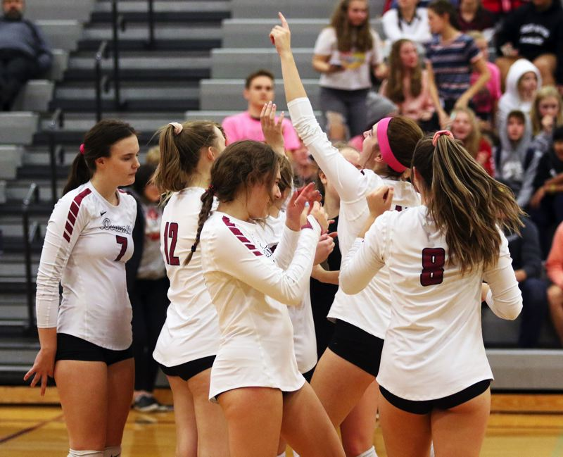 PMG PHOTO: DAN BROOD - The Lady Bowmen celebrate following the final point of their 3-0 sweep against Forest Grove in the Oct. 9 Pacific Conference contest.