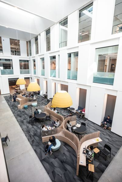 PMG PHOTO: JONATHAN HOUSE - A basement-level student lounge benefits from the creation of a light well through the center of the former Neuberger Hall building, now called Fariborz Maseeh Hall.