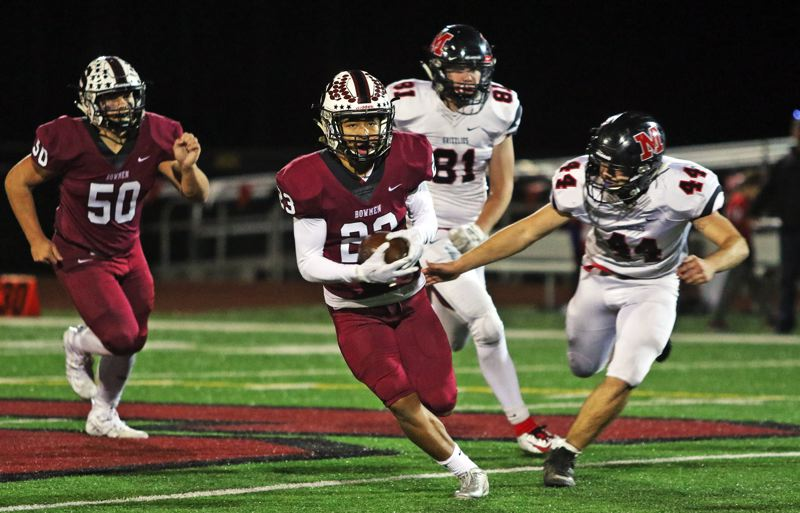 PMG PHOTO: DAN BROOD - Sherwood High School senior Jamison Guerra (23) breaks into the clear for a 14-yard gain during the second half of the Bowmen's 42-10 victory over McMinnville on Thursday.