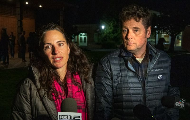 PMG PHOTO: JONATHAN HOUSE - Mary and Dustin Klinger spoke with media after a vigil for their missing son Owen on the campus of the University of Portland.