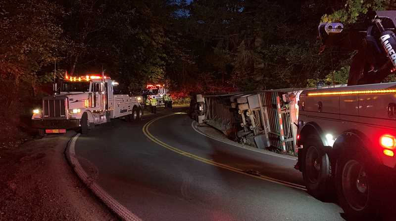 WASHINGTON COUNTY SHERIFF'S OFFICE PHOTO - Five different trucks were at the scene of a crash involving an overturned semi truck on NW Old Cornelius Pass Road to try to help remove the vehicle Friday, Oct. 11.