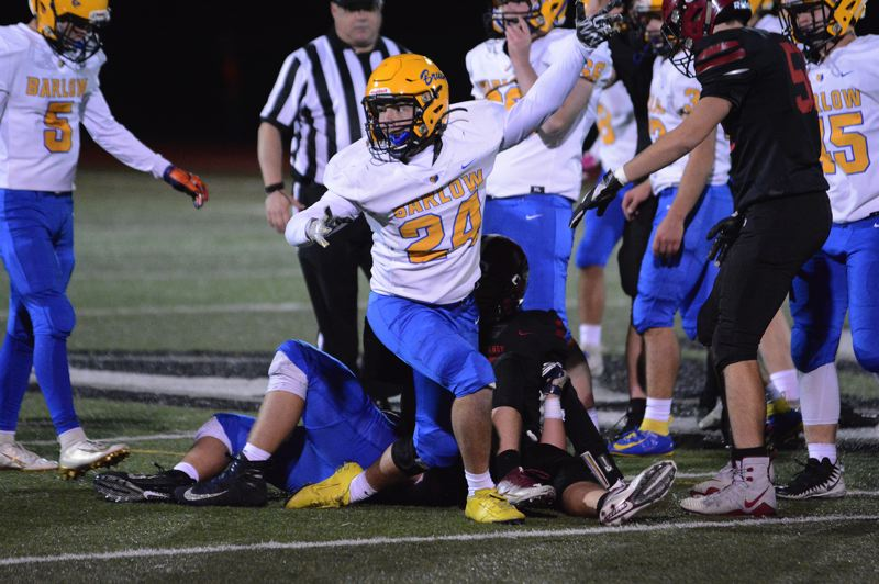 PMG PHOTO: DAVID BALL - Barlows Drake Payne lets the sideline know which way the ball is going after getting in on a tackle for a fourth-down stop in the Bruins 36-0 win at Sandy.
