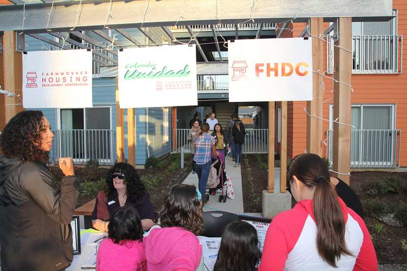 PMG PHOTO: JUSTIN MUCH - Many attendees at the Colonia Unidad Benefit took tours of the units at the brand new complex.