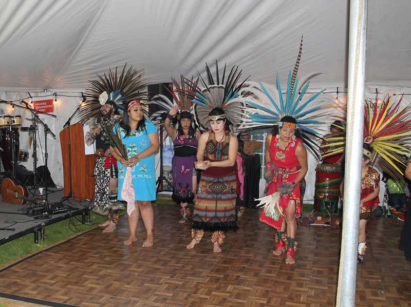 PMG PHOTO: JUSTIN MUCH - Aztec Danza in full regalia provided entertainment and a blessing of the grounds during the Colonia Unidad Benefit held Friday evening.