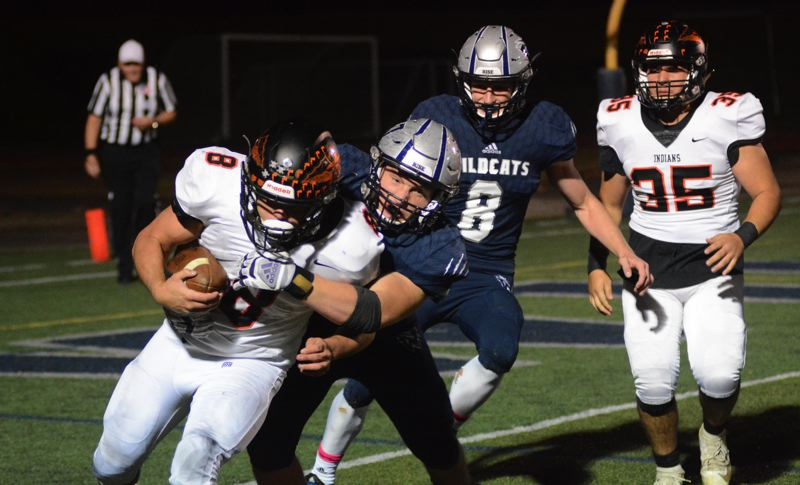 PMG PHOTO: DEREK WILEY - Wilsonville junior Jake Moore sacks Scappoose quarterback Jakobi Kessi Thursday night.